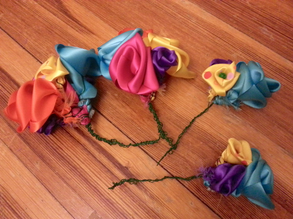 little ribbon flowers on green wire stems, laid out on the floor