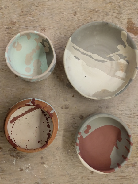 four glazed, unfired bowls