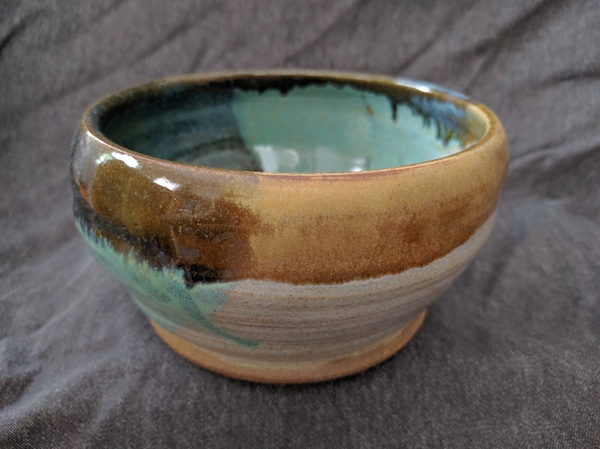 side view of a bowl, white and green and yellow