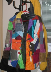 front of a very colorful patchwork coat