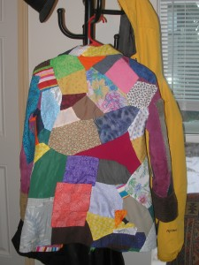 the back of a very colorful patchwork coat
