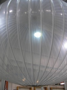 a large pumpkin-shaped, translucent balloon