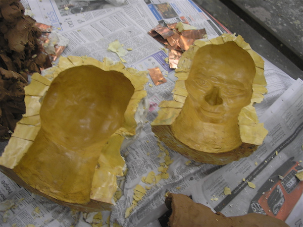 two empty halves of the mold, clean, shiny with shellac