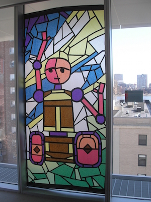 colorful stained glass style robot in a window