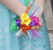 colorful satin ribbon flowers in a corsage on a woman's wrist