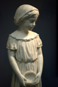 _statue of a young girl holding a nest_