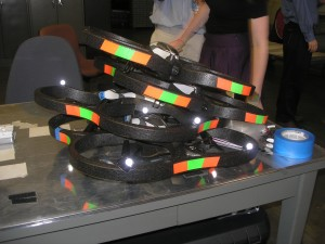 several quadcopters stacked up in a pile